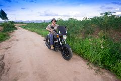 Men riding a motorcycle. In the countryside Stock Photography