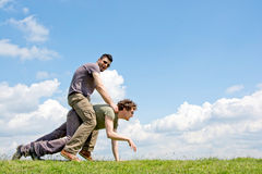 Men riding one over another Royalty Free Stock Photo