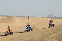 Men Riding Quad Bikes In Desert Stock Photos