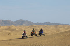 Men Riding Quad Bikes In Desert Royalty Free Stock Photography