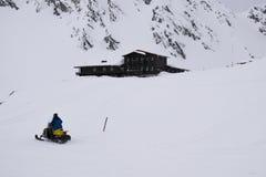 Men riding snowmobile royalty free stock photo