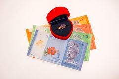 Men ring inside red box with Malaysian currency notes Stock Photography