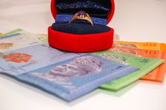 Men ring inside red box with Malaysian currency notes Royalty Free Stock Images