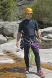 Men in river with equipment to canyoning Royalty Free Stock Photography