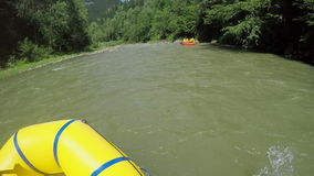 Men rob with a paddle on rafting boat. Rafting boat on the fast mountain river in Carpathians. Hands view. stock video