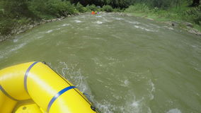Men rob with a paddle on rafting boat. Rafting boat on the fast mountain river in Carpathians. Hands view. stock footage