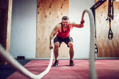 Men with rope in functional training fitness. Gym Stock Photos