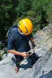 Men with rope for rappelling Stock Photo