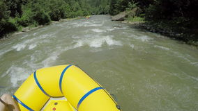 Men row with a paddle on rafting boat. Rafting boat on the fast mountain river in Carpathians. Hands view. stock video footage