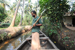 Men rowing his canoe on a river of the backwaters at Kollam Stock Photos