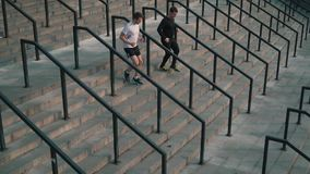 Men run down the stairs.  stock footage