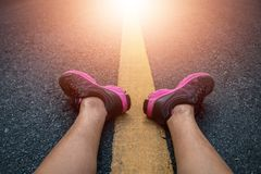 Men runner feet on road in workout wellness. Men runner feet on road in workout wellness concept Stock Images