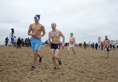 Men running on the beach, Belgium Stock Photos