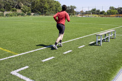 Men running on outdoor playing field Stock Photography