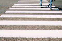 Men running on pedestrian zebra Stock Images