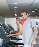 Men Running On Treadmill Royalty Free Stock Photos