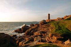 Men ruz lighthouse at Pink Granite coast in Brittany. Phare de Men Ruz. Côte de Granit Rose is one of the most beautiful stretches of Brittany's royalty free stock images