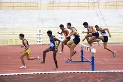 Men's 3000 Meters Steeplechase. Image of the men's 3000 meters steeplechase event at the Negeri Sembilan Open Athletic Meet held at Paroi Stadium, Seremban Royalty Free Stock Image