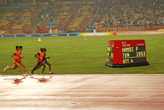 Men's 5000m T11 competition. From right in blindfolds, Kenya's Henry Wanyoike and China's Zhang Zhen take part in the final of the Men's 5,000 meter race with Stock Photography