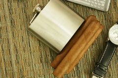 Men's Accessories. Close up of  cigars, hip flask, hand watch and phone Stock Image