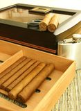 Men's Accessories. Cigars, cigar humidor, hip flask. Close up Stock Image