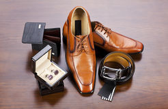 Men's accessories. Men' s accessories in style: belt, cuff, wallet, leather shoes royalty free stock photos