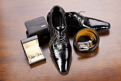 Men's accessories. Men' s accessories in style: belt, cuff, wallet, leather shoes stock photography