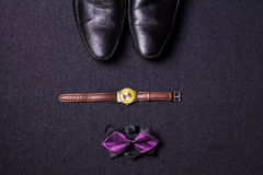 Men`s accessories on black background tie wallet watch strap sho. Es Royalty Free Stock Image