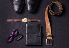 Men`s accessories on black background tie wallet watch strap sho. Es Stock Images