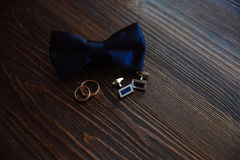 Men`s accessories. Bow-tie, cufflinks, gold rings. Groom details Royalty Free Stock Images