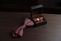Men`s accessories. Bow-tie, cufflinks. Groom details Stock Photos