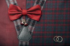 Men`s accessories - bow tie, wedding rings, cufflinks on textile background. Royalty Free Stock Images