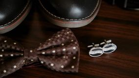 Men`s accessories, butterfly shoes cufflinks and belt.