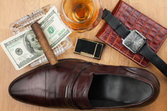Men's accessories, cigar, ashtray, lighter, money, shoe, glass Royalty Free Stock Image