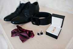Men`s accessories for groom, wedding rings, shoes, belt, cufflin. Ks and bow tie Stock Photo