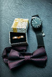 Men`s accessories for groom at wedding: watches, bow tie and rings. Stock Image