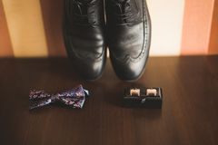 Men`s accessories with luxury shoes. Top view.  Royalty Free Stock Photo