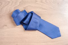 Men`s accessories men`s shoes, tie on a wooden background. Classic men`s accessories. Top view Stock Image