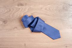 Men`s accessories men`s tie on a wooden background. Classic men`s accessories. Top view Royalty Free Stock Photo