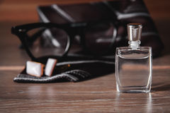 Men`s accessories. Perfume with tie Stock Image
