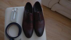 Men`s accessories. Shoes, belt and toilet water. Close up. Beautiful accessory stock video