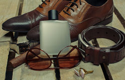 Men's accessories. Shoes and perfume Royalty Free Stock Photography
