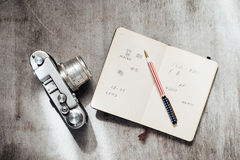 Men's Accessories , top view on a wooden background Retro camera notebook pen Stock Photos