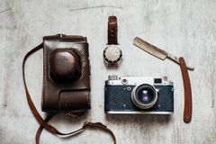Men's Accessories , top view on a wooden background Retro camera watch razor Stock Photo
