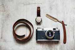 Men's Accessories , top view on a wooden background Retro camera watch razor Royalty Free Stock Photos