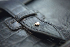 Men`s accessories in vintage style, macro shot, selective focus. A black leather bag. The buckle - detail Royalty Free Stock Photos