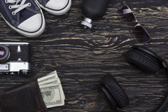 Men's accessories: wallet, headphones, sunglasses, perfume, camera and sneakers. Stock Photos