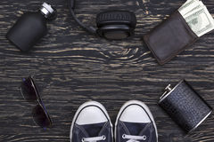 Men's accessories: wallet, headphones, sunglasses, perfume, flask and sneakers. Stock Image