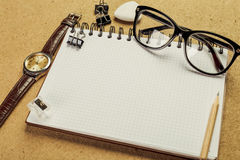 Men's accessory. Notepad watch glasses stock photo