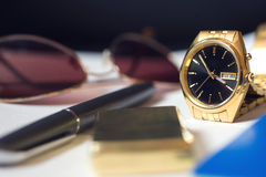 Men's accessory, passport, pen, golden watch Stock Photography
